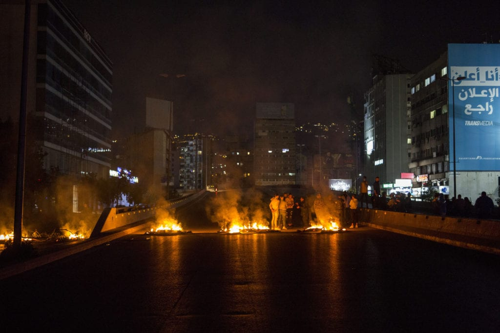 Demonstrators burn tires in early March, blocking main roads in Beirut.
