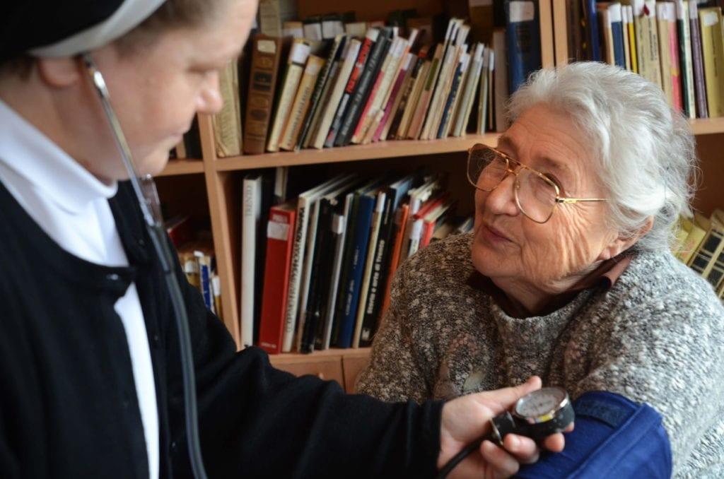 a nun gives a woman a checkup in Georgia.