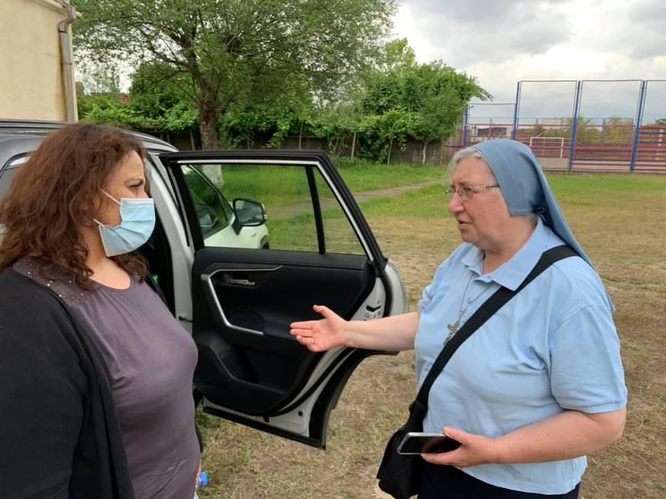 Anahit Mkhoyan (left), executive director of Caritas Georgia, speaks with Sister Loredana Monetti, who operates the Caritas programs in Kutaisi.