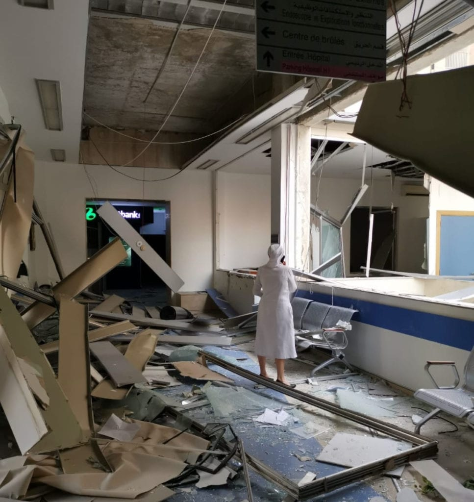 a nun stands in the rubble of the severely damaged Geitawi Hospital in Beirut.