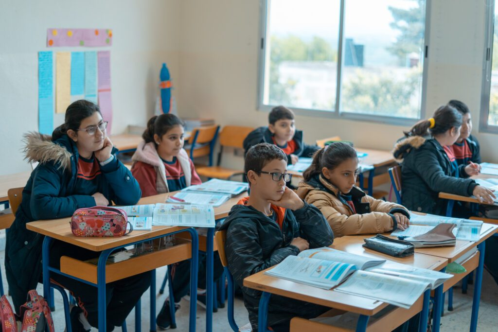 Students sit in a classroom at Holy Family School in Alma El Shaab, Lebanon.